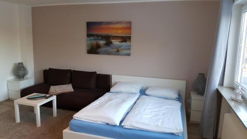 Ein Bett oder Betten in einem Zimmer der Unterkunft Ambiente Apartment