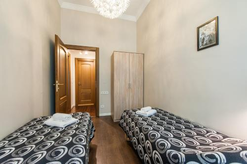 Lova arba lovos apgyvendinimo įstaigoje Delta Apartments - Town Hall