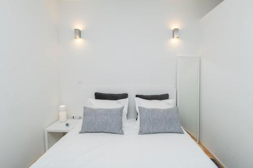 A bed or beds in a room at BO - Almada 346