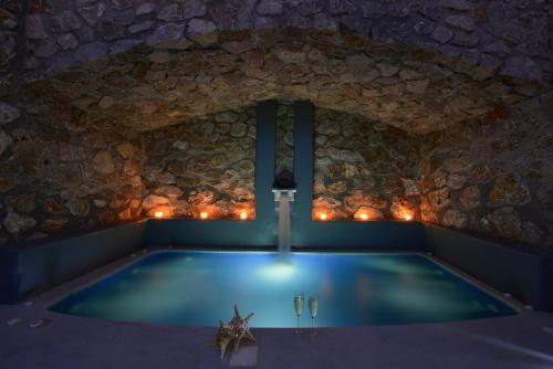 The swimming pool at or close to Pleiades Eco Houses