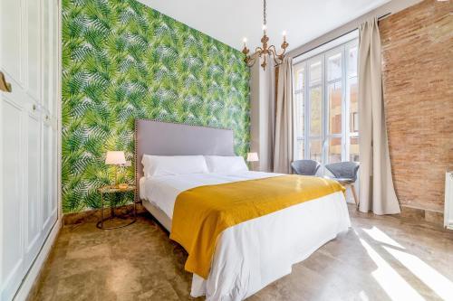 A bed or beds in a room at Palacio de Rojas