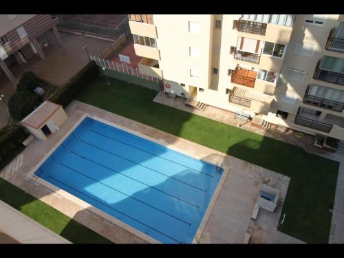 A view of the pool at Apartamentos Vacacionales Geminis or nearby