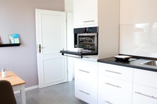 Küche/Küchenzeile in der Unterkunft Ferienwohnung Amseli