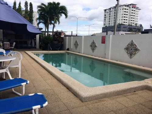 The swimming pool at or near Inner City Granny Flat