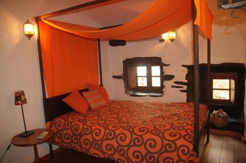Uma cama ou camas num quarto em Aldeia Oliveiras