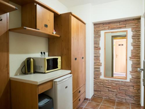 A kitchen or kitchenette at Apartmány Teddy Bojnice