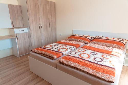 Postel nebo postele na pokoji v ubytování Nad Šťastným sklepem