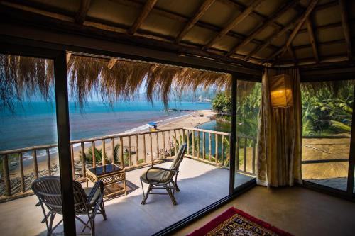 A balcony or terrace at Dwarka Eco Beach Resort