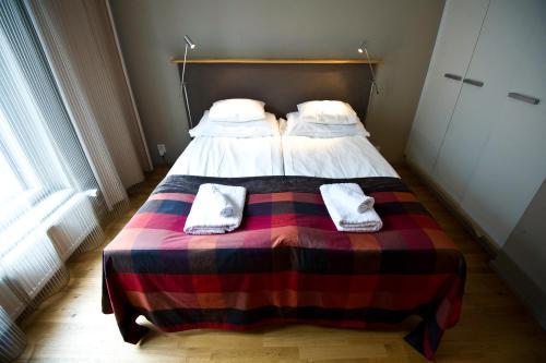 Een bed of bedden in een kamer bij Levi Suites Levin Klubi
