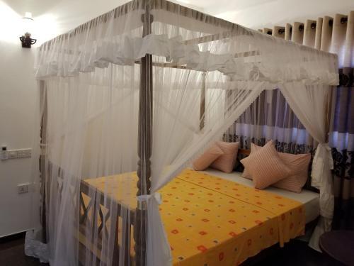 Кровать или кровати в номере Coral Palm Villa and Apartment