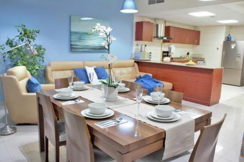 A restaurant or other place to eat at A C Pearl Holiday Homes - Sea and Palm view Three Bedroom Apartment