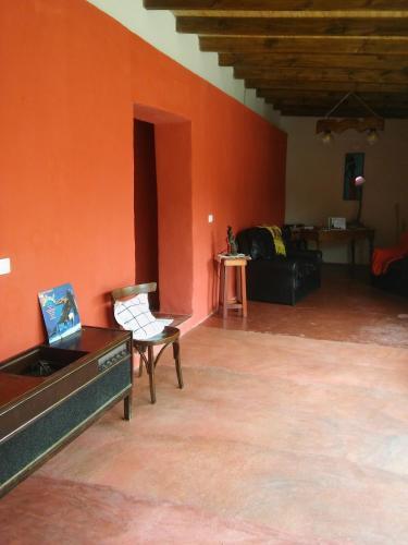 Una televisión o centro de entretenimiento en Aires Cordilleranos Posada