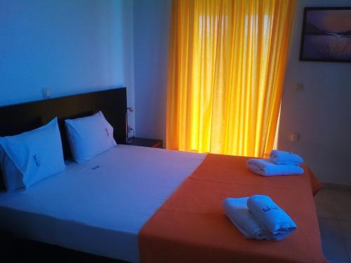 A bed or beds in a room at Irida Hotel