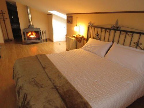 Cama o camas de una habitación en Elai Etxea Loft Baias