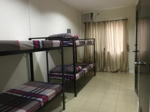 A bunk bed or bunk beds in a room at One Terence Residences