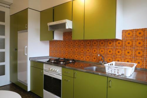 A kitchen or kitchenette at Zurich Furnished Apartments