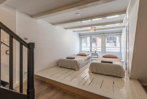 A bed or beds in a room at Old Town 1 Apartment