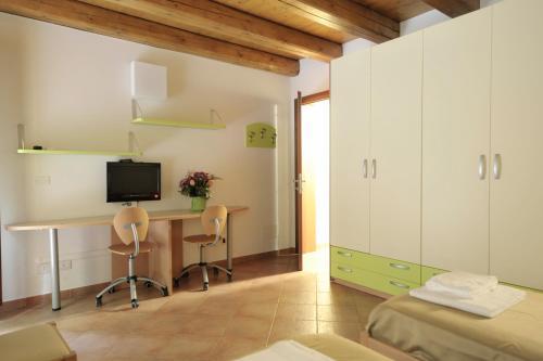 TV o dispositivi per l'intrattenimento presso Residence Cavazza