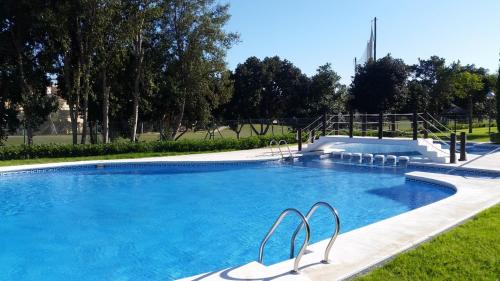 Het zwembad bij of vlak bij Casa En El Campo Del Golf De Playa De San Juan