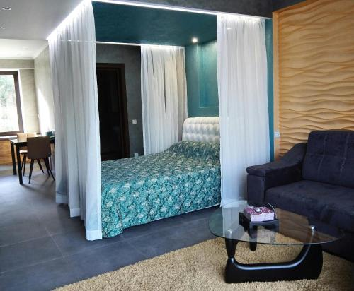 A bed or beds in a room at Luxury Apartment in Baikal Hill Residence