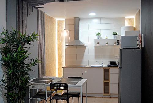 A kitchen or kitchenette at Casa Faroleiro