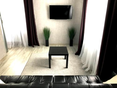 A television and/or entertainment center at Lux Apartment Penza Centr
