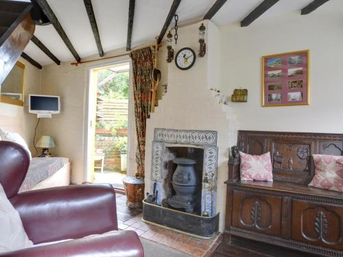 A seating area at English Cottage in Hastings Kent with Coal Burning Stove