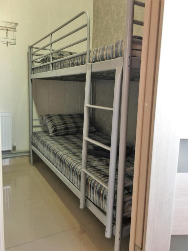 A bunk bed or bunk beds in a room at Hostel TIZORY