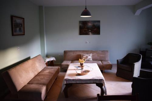 A seating area at Daphne & Maria Apartments