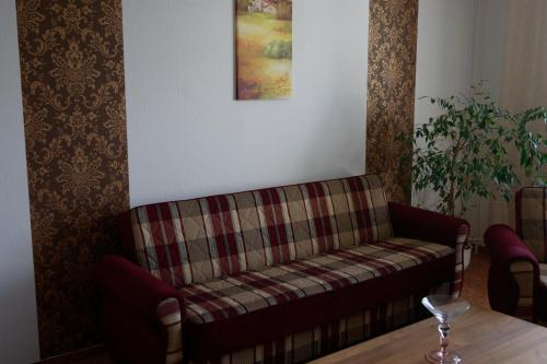 A seating area at Apartment-Hotel Rackwitz