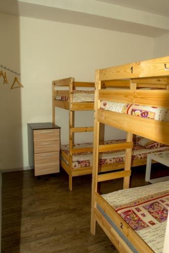 A bunk bed or bunk beds in a room at Hostel Travel