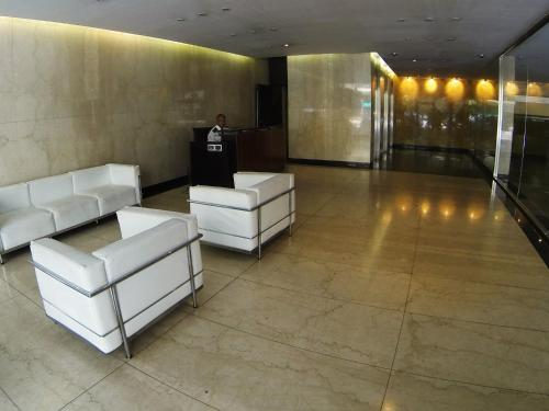 The lobby or reception area at Concord Callao by Temporary Apartments