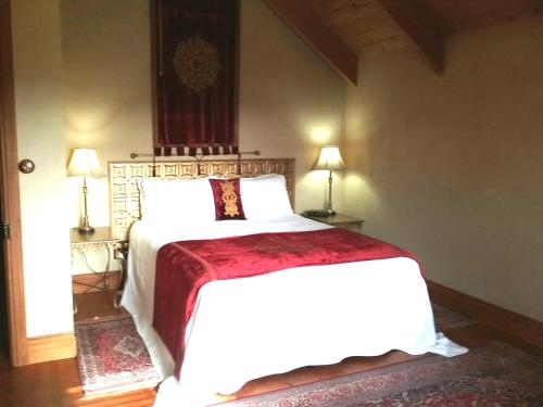 A bed or beds in a room at Kentisbury Country House