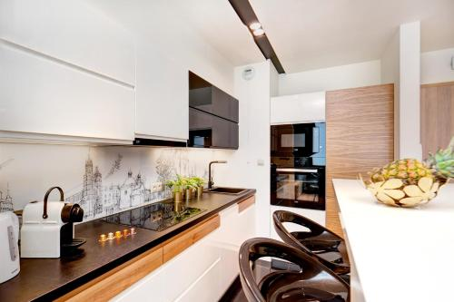 A kitchen or kitchenette at Bed&Bath Boulevard Apartments