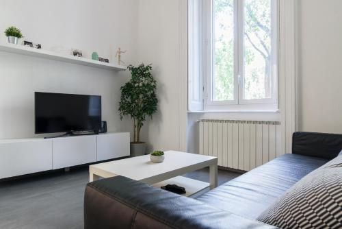 A seating area at Bergognone Apartment