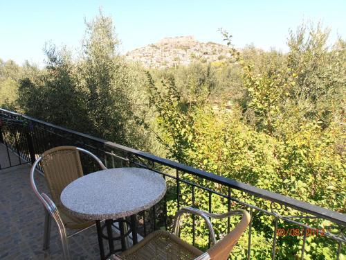 A balcony or terrace at O' Kipos