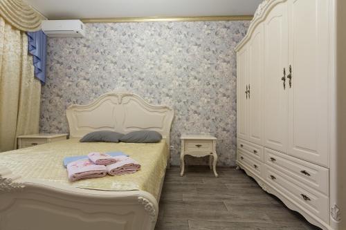 Кровать или кровати в номере Apartments Lux pl.Lenina 12/1