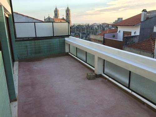 A balcony or terrace at São Brás Apartment