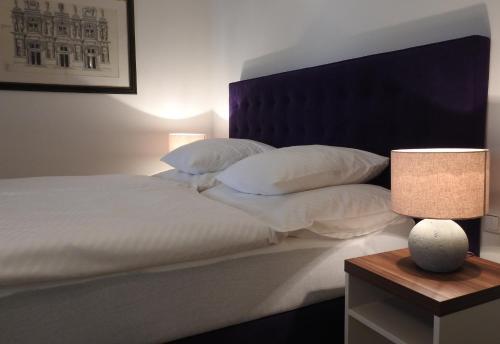 A bed or beds in a room at Studio Hofer
