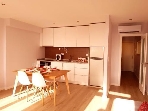 A cozinha ou cozinha compacta de Innapartments São Gonçalinho II