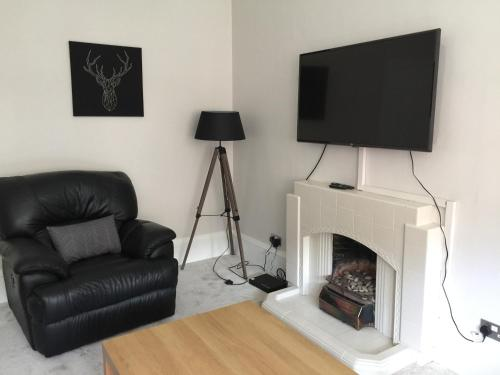 A television and/or entertainment center at Apartment 2 Bed West End