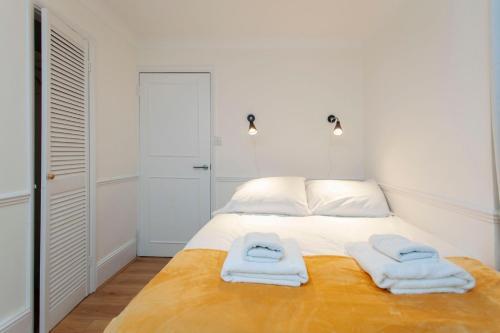 Letto o letti in una camera di ItalianFlat - Warwick