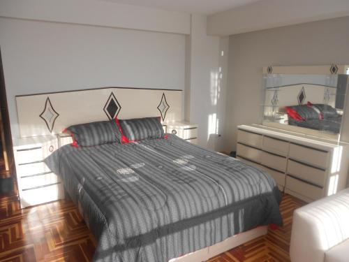 Cama o camas de una habitación en Appartement meublé