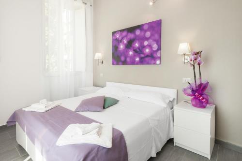 Un ou plusieurs lits dans un hébergement de l'établissement Residenza Maxima