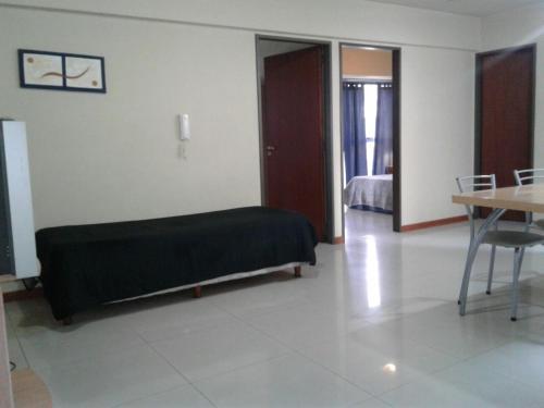 Una cama o camas en una habitación de Departamento Aconcagua