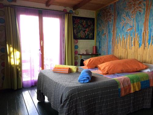 A bed or beds in a room at Casa sull'Albero