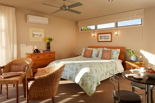 A bed or beds in a room at Almyra Waterfront Accommodation