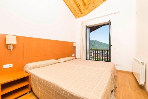 Cama o camas de una habitación en Guitart La Molina Aparthotel & Spa