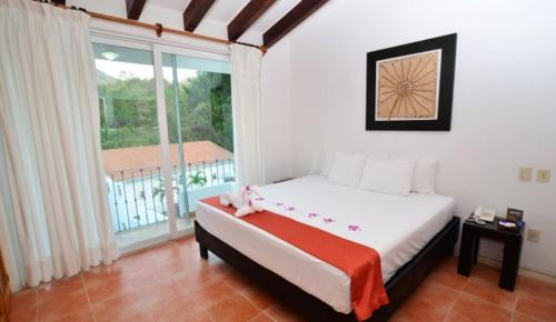 A bed or beds in a room at Villa - All Inclusive!
