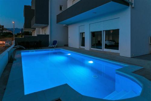 The swimming pool at or close to VIP Deluxe Villa JASMINA